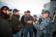 (L-R) Jep Robertson, Willie Robertson, Matt Light and Adam LaRoche listen to a presentation of the USS Stout by U. S. Navy Chief Peter Wilkinson, Jr.from Fairfield, CT on December 7. The group is in the region as part of a seven-day, four-country USO holday tour being led by General Martin Dempsey. The is the first USO experience for all four men. (Mike Clifton/USO)